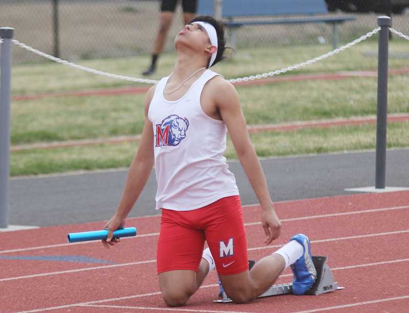 STEELE HAUGEN - Leo Gutierrez looks to the sky before starting the first leg of the 4x100-meter releay race