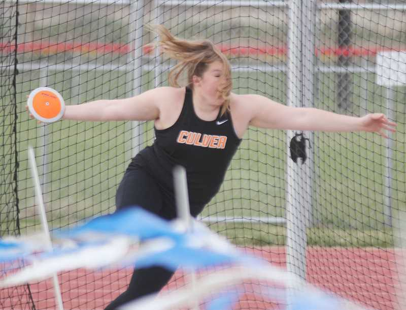 STEELE HAUGEN - Catylynn Duff throws the discus in the April 18, meet in Madras. Duff placed first.