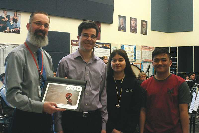 LK - Jason Rodgers (left) shows his Eugene Kaza Music Educator Award, which was presented to him by Portland Youth Philharmonic Music Director David Hattner, and for which he was nominated by students Adriana Loera and Nicohlas Pajela.