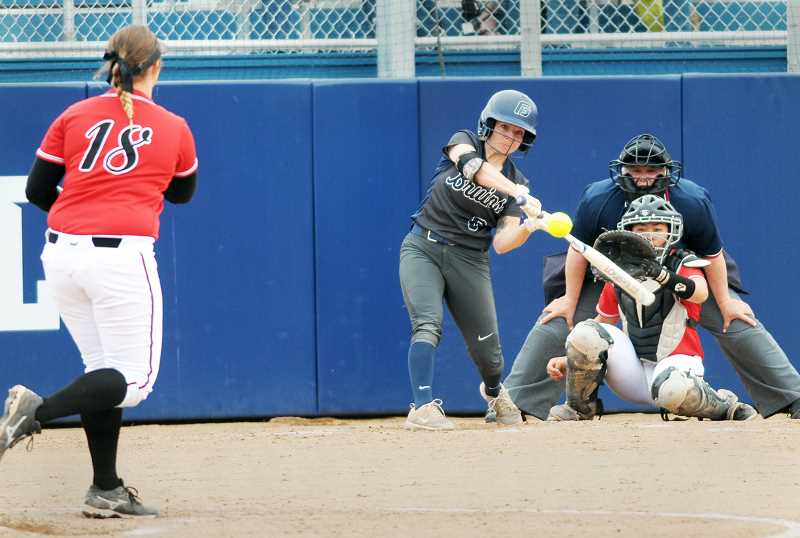 SETH GORDON - Rebecca Pridmore takes a cut during George Fox's 10-2 home loss to Pacific in the opening game of the NWC Tournament Friday afternoon. The Bruins later avenged the loss with a 7-2 win Saturday, but fell to Linfield 9-1 in the championship game.