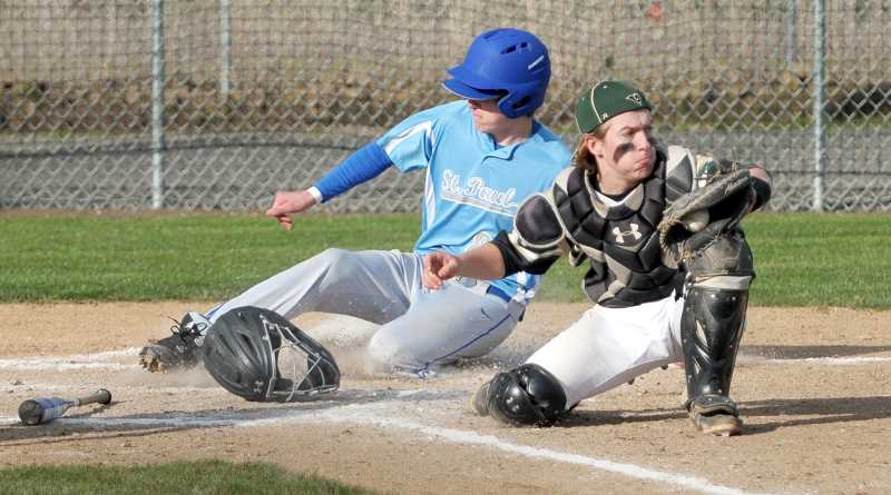 SETH GORDON - Holden Smith slides into home plate during St. Paul's 10-9 home loss to Regis April 18. The Bucks bounced back from the setback with wins over East Linn Christian and Santiam to improve to 5-2 in Tri-River Conference play.
