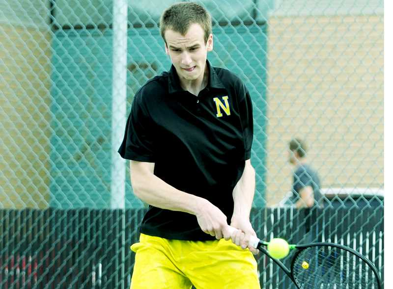 SETH GORDON - Senior Matt Weiler slams a return during Newberg's home match versus Tualatin April 18. Weiler and partner Quinton Nigbur won their match at No. 1 as part of a Tigers sweep in doubles.