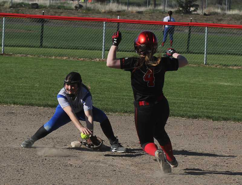 STEELE HAUGEN - Freshman Delaney Vibbert tag out a Corbett runner trying to steal second base.