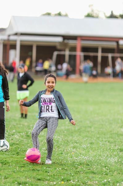 COURTESY PHOTO - Girls in the academy learn basic soccer skills as well as ways to stay active and healthy in their own time.
