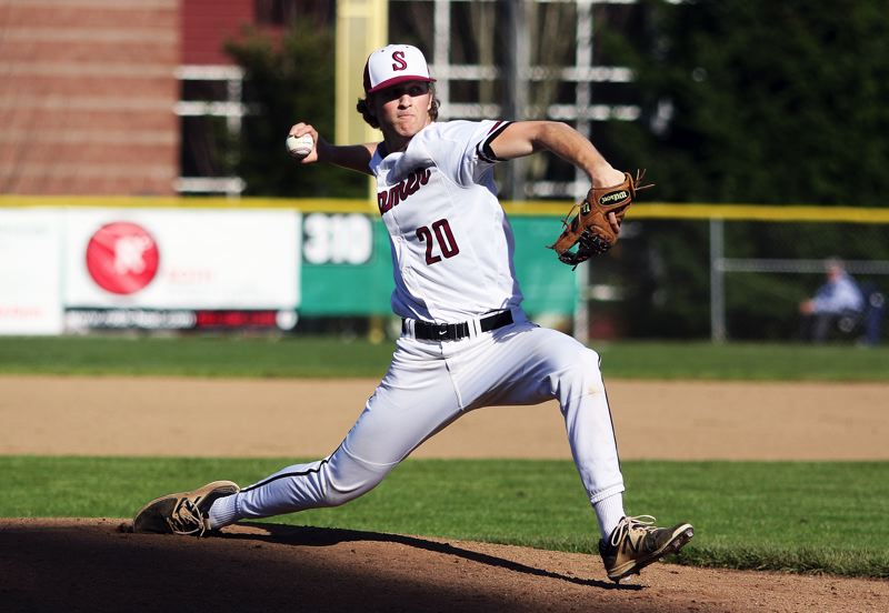 TIMES PHOTO: DAN BROOD - Sherwood High School senior Riley Aggson fires in a pitch to the plate during the Bowmens 6-0 win over Tualatin in Three Rivers League play.