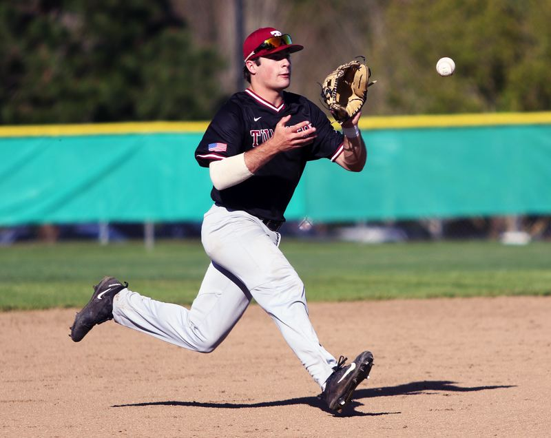 TIMES PHOTO: DAN BROOD - Tualatin High School junior shortstop Kyle Dernedde gets ready to make a play during the Timberwolves game at Sherwood.