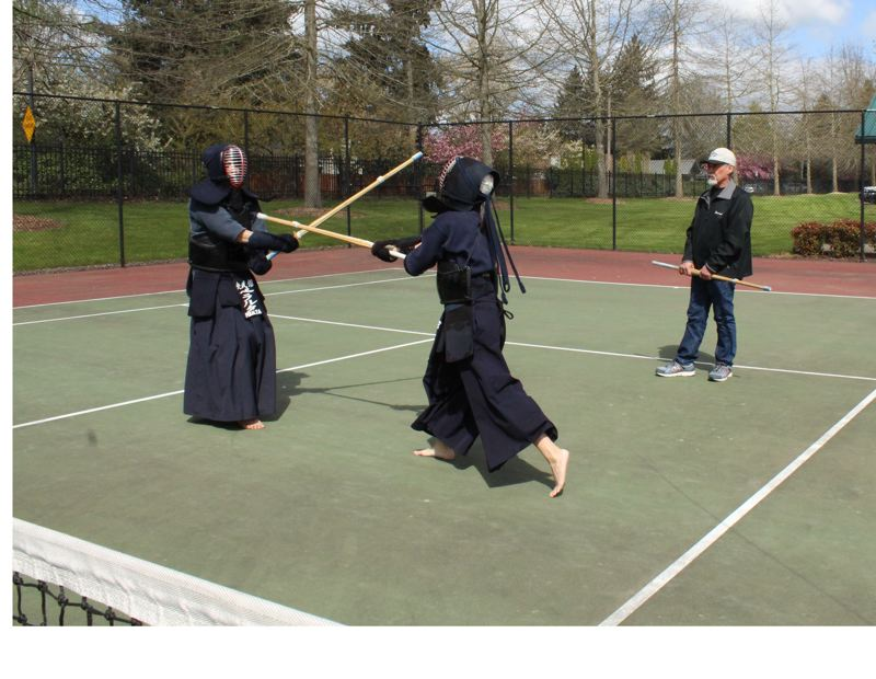 STAFF PHOTO: OLIVIA SINGER - A Kendo karate demonstration at the event featured participants swordfighting in full protection using bamboo swords.