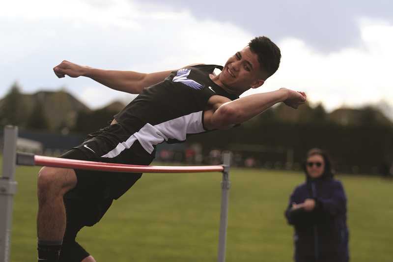 PHIL HAWKINS - Woodburn junior Nathan Corpuz added four inches to his personal record in the high jump, clearing 5-04 to finish tied for second with teammate Tyson Doman on April 18.