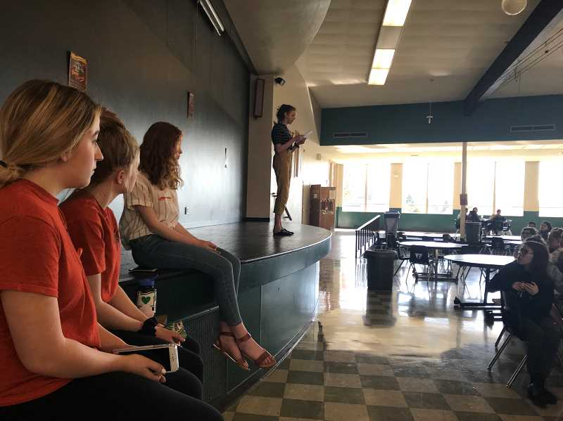 COURTESY OF CAIT SMITH - Baylee Bergquist, left, Olivia Young and Meghan Turley listen to Jessica Woolfolk speak during a walkout to support sensible gun control held at Tigard High School Friday.
