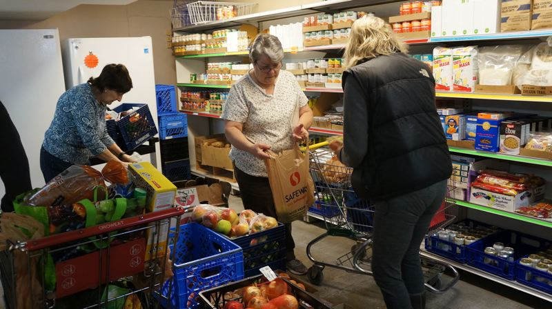 PHOTO COURTESY OF JOHN AND DIANNE ETTER - Kathy Horne, center, assists with shopping in the Zarephath food pantry.
