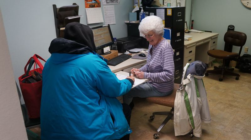 PHOTO COURTESY OF JOHN AND DIANNE ETTER - Volunteer Jan Freiley assists a Zarephath client.