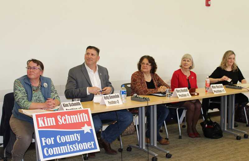 HOLLY GILL/MADRAS PIONEER - From left, Kim Schmith, Kelly Simmelink, Mary Kendall, Mae Huston and Courtney Snead prepare for questions from moderators of last week's candidate forum for county commissioner positions.