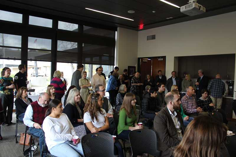 Dozens of residents, City staff members and police department employees gathered for the public reception April 18.