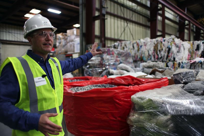 JESSIE DARLAND - John Desmarteau, Agilyx project Engineer, gives a tour during the companys ribbon cutting on April 19, celebrating the opening of the first-of-its-kind polystyrene recycling facility.