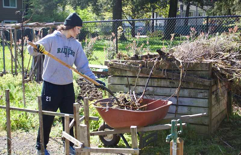 OUTLOOK PHOTO: CHRISTOPHER KEIZUR - Volunteer Alyssa Felix helps with the composting at Nadaka Nature Parks Community Garden.