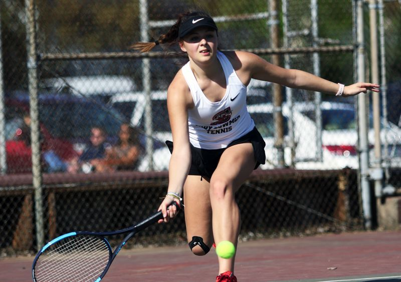 TIMES PHOTO: DAN BROOD - Sherwood High School junior Emily McDonald hits a forehand shot during No. 1 singles play during Mondays league match at Tigard.