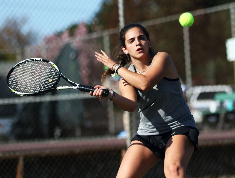 TIMES PHOTO: DAN BROOD - Tigard senior Natalia Lucas Morato, a foreign exchange student from Spain, hits a shot during No. 1 singles play in the Tigers' match with Sherwood.