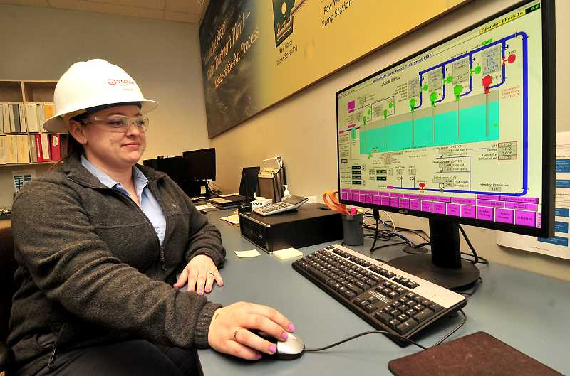 SPOKESMAN PHOTO: VERN UYETAKE - Operations and maintenance technician Ashley Reeder, mans the controls at the Wilsonville Water Treatment Plant. City officials are discussing long-range plans for expansion of the facility.