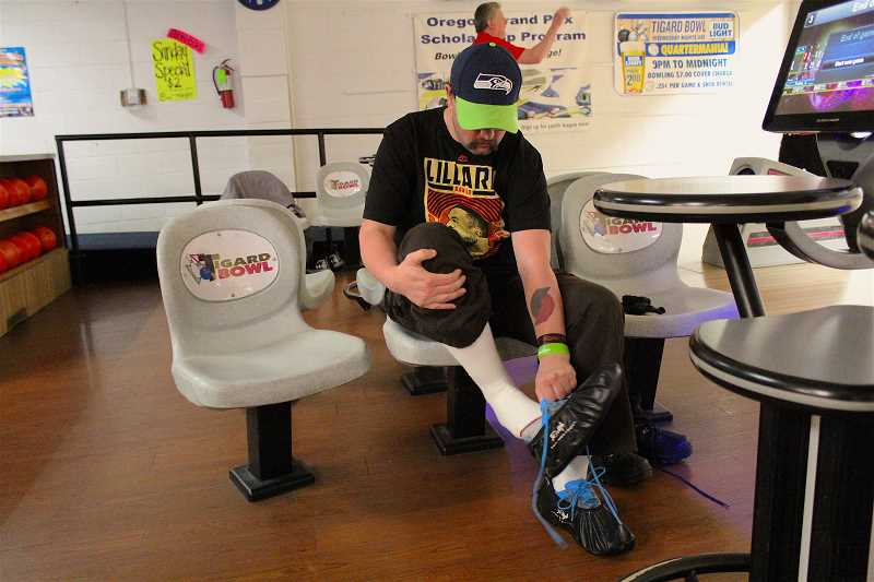 REVIEW PHOTO: SAM STITES - Richie Gensman prepares to bowl at Tigard Bowl. These arent your grandfather's bowling shoes, however; Gensman keeps them in little protective booties so the tread remains clean.
