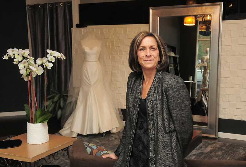 REVIEW PHOTO: VERN UYETAKE - Lake Oswego resident Monica Mayer has brought her Divine Designs Bridal Boutique back to Lake Oswego. She offers brides private appointments in her salon to select that perfect dress for the wedding day.