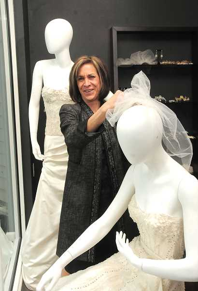 REVIEW PHOTO: VERN UYETAKE - Monica Mayer says bridal veils are coming back, along with more classic styles of wedding gowns. She carries collections of couture designers and a full range of accessories in Divine Designs Bridal Boutique.