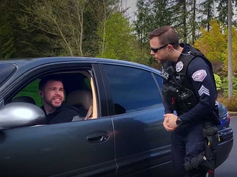 PHOTO COURTESY OF LOPD TV - In a video about distracted driving, LOPD Sgt. Clayton Simon pulls over a (very familiar-looking) driver for watching a video on his cellphone.