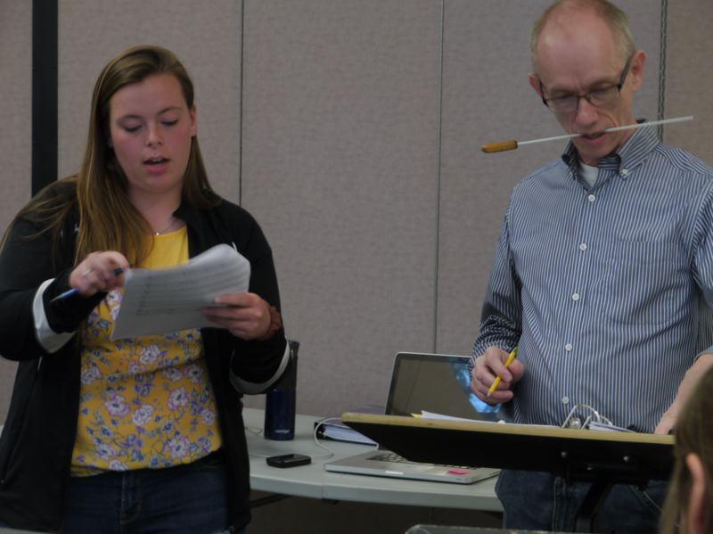 COURTESY PHOTO - Composer Lindsey McAllister (left), a senior at Hermiston High School, discusses the performance of her chamber music piece with Jeff Payne, director of the Yougn Composers Project.