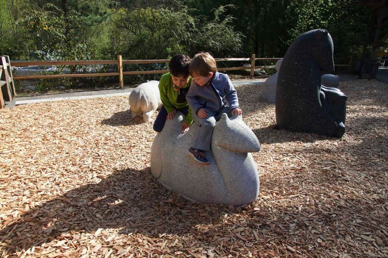 COURTESY: KELSEY WALLACE/OREGON ZOO - Kids play on a camel sculpture in the newly reinstalled Warren J. Iliff Sculpture Garden at the Oregon Zoo.