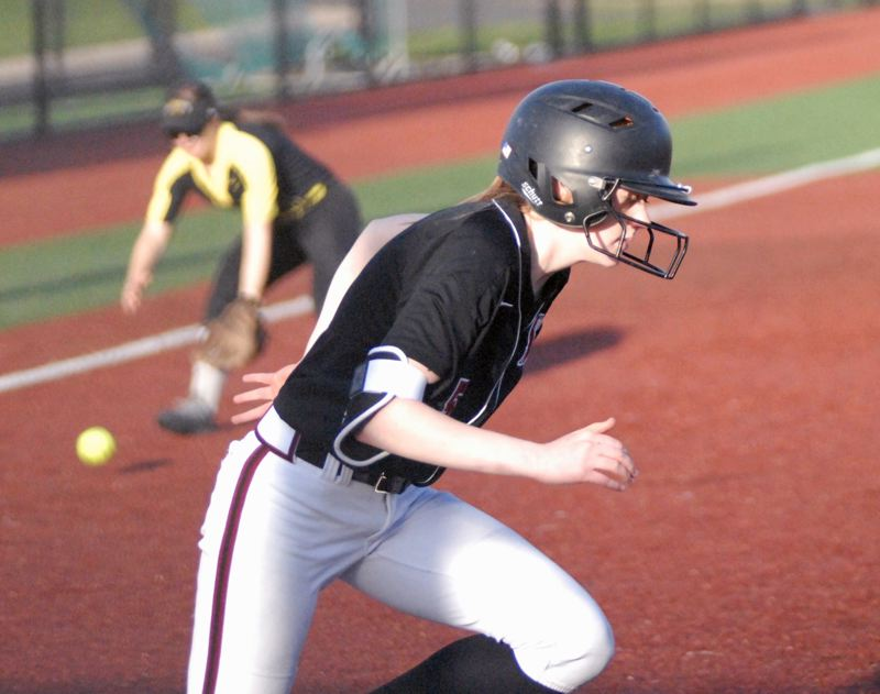 SANDY POST: MATT RAWLINGS - Sandy's Jenna Eslinger tries to beat out a slow ground ball to the left side.