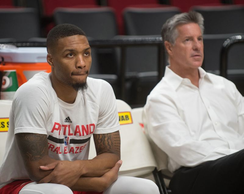 TRIBUNE FILE PHOTO - General manager Neil Olshey (right) says the the Trail Blazers, led by All-Star guard Damian Lillard (left) were 'far more conservative in our expectations' for the playoff series against New Orleans than pundits who picked Portland to win.