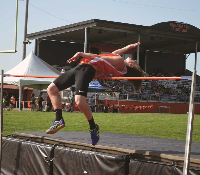 PIONEER PHOTO: TANNER RUSS - Molalla senior Marcus Simpson leaps over the bar in the high jump on Wednesday, April 25. Simpson took second place in the event, behind Molalla junior Nick Lucas.