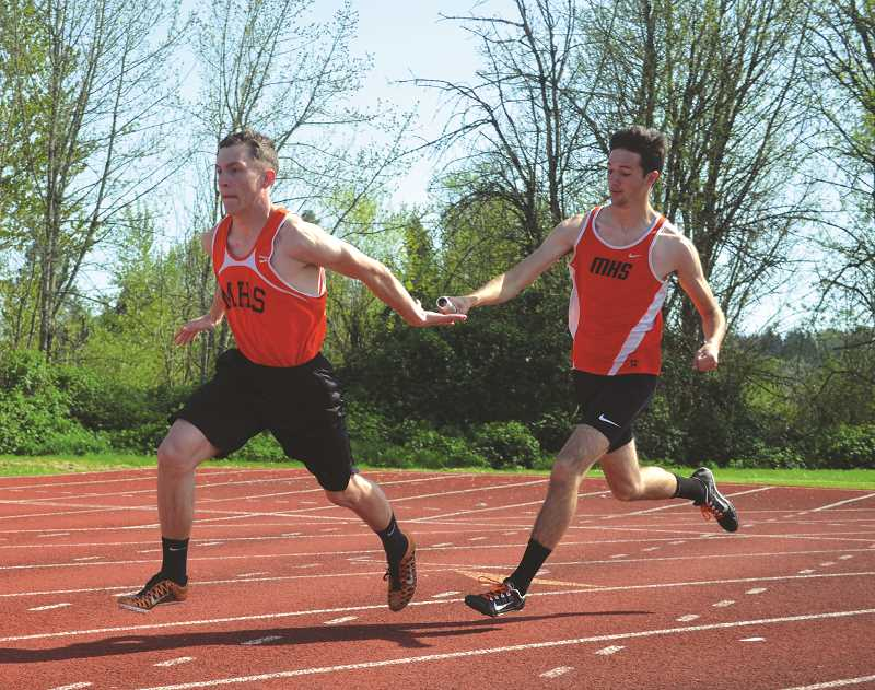 PIONEER PHOTO: TANNER RUSS - Molalla's 4x100 meter relay took second place against Madras and Estacada.