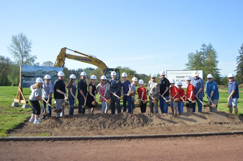 SPOTLIGHT PHOTO: NICOLE THILL - A group of St. Helens School District staff, students, school board and community members take part in a ceremonial groundbreaking at the new St. Helens Middle School building site on Wednesday, April 25. The ceremony took place nearly a month after a similar event was held to kickoff construction of the districts new alternative high school education campus.