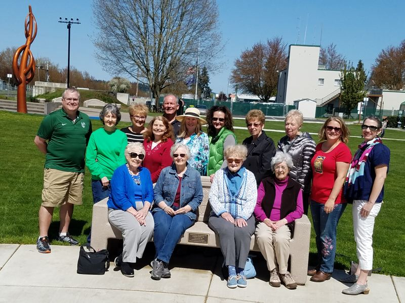 PHOTO COURTESY OF SCAPPOOSE GARDEN CLUB - Scappoose Garden Club members meet with Scappoose city officials for a dedication ceremony Sunday, April 22. Pictured back row, left to right: Scappoose Mayor Scott Burge, Karen VanSwearingen, Sue Hobart, Beth Kennedy, Scappoose City Manager Michael Sykes, Byrd Schneider, Kelly Kessi, Pat Thomas, Mary Jane McDonald, Michelle Berg, and Jessica Miller. Front row: Patty Pribyl, Judy Thompson, Maureen Kessi and Mary Kucera.