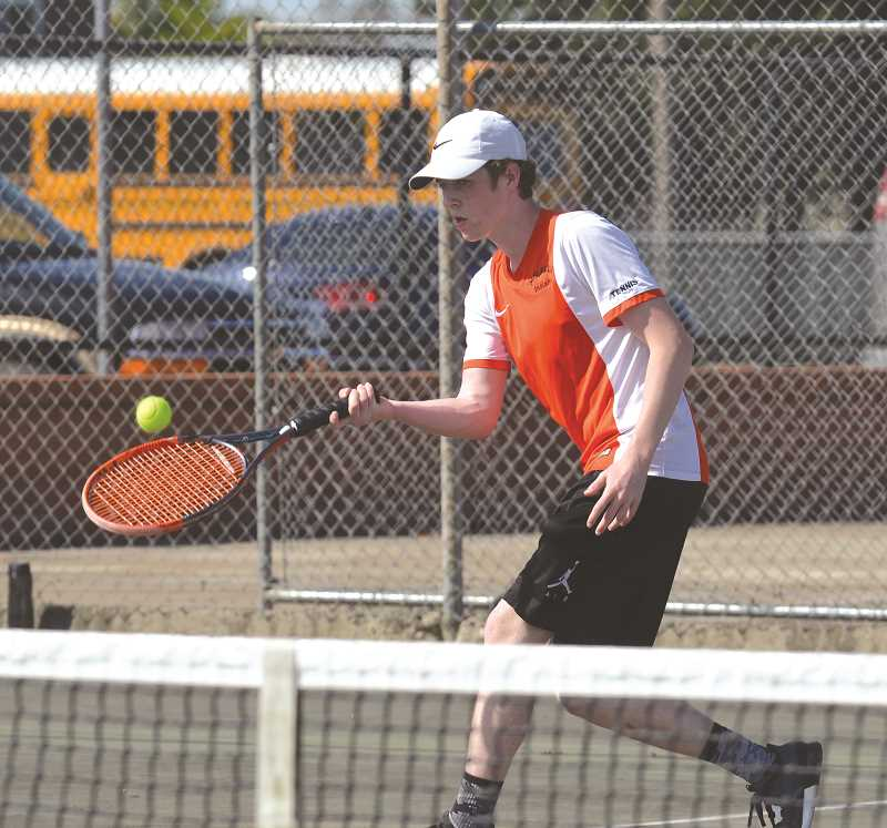 PIONEER PHOTO: TANNER RUSS - Logan Child, Molalla's number one singles player, lost a close match to Madras's Brandon Salgado. However, Molalla was able to best the visiting White Buffaloes 5-3 on Tuesday, April 24.