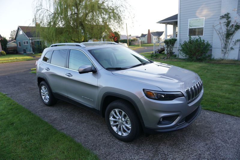 PORTLAND TRIBUNE: JEFF ZURSCHMEIDE - The new features are mostly aesthetic, focusing on the headlights, grille, and the hood, but the visual effect is to take the Cherokee upscale, looking more mature and serious.