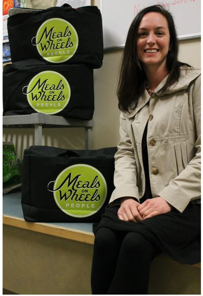 OUTLOOK PHOTO: ANNE ENDICOTT - Brianna Bigham is the director of the Ambleside Meals on Wheels program at the Gresham Senior Center. She oversees the distribution of 270 meals to homebound seniors each day, as well as preparpation of 70 lunches for those who come into the center.