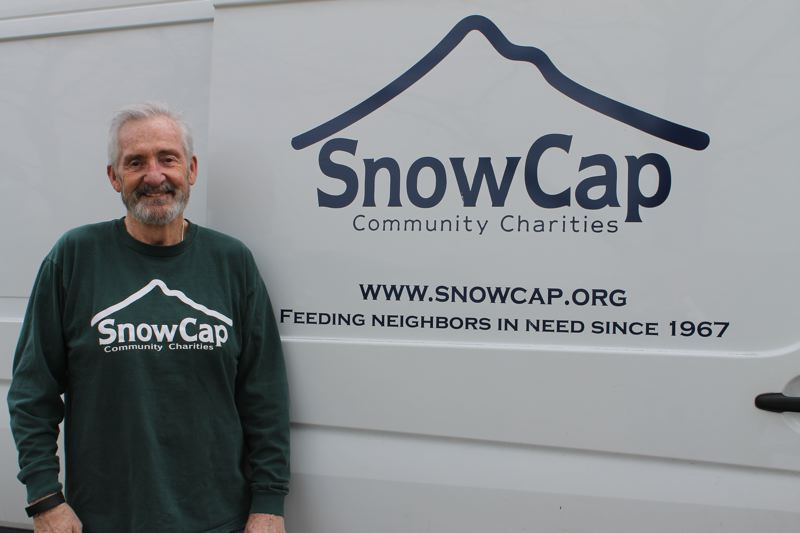 PAMPLIN MEDIA PHOTO: ANNE ENDICOTT - Gresham resident Larry Carroll volunteers three days each week with SnowCap Community Charities. Over his seven years with the agency, Carroll has logged more than 5,500 hours delivering food, providing intake services and helping with SnowCaps annual fundraising auction.