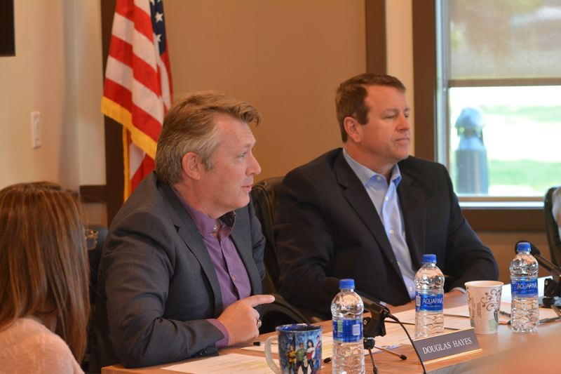 SPOTLIGHT PHOTO: COURTNEY VAUGHN - Port of St. Helens Executive Director Doug Hayes (center) pitches a name change to port commissioners Wednesday, April 25. To his right, port attorney Robert Salisbury listens in.