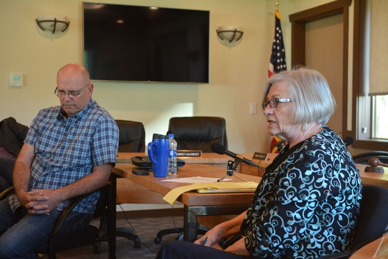 SPOTLIGHT PHOTO: COURTNEY VAUGHN - Port of St. Helens Commissioners Larry Ericksen and Paulette Lichatowich listen to feedback and dialogue among a group of a dozen residents during a listening session at the ports office Wednesday, April 25.