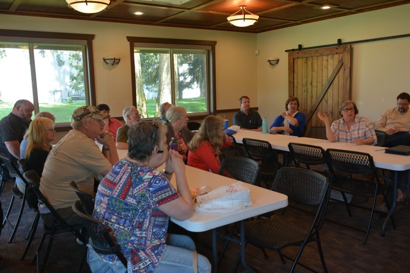 SPOTLIGHT PHOTO: COURTNEY VAUGHN - Attendees of an afternoon listening session hosted by the Port of St. Helens Wednesday, April 25, address issues like development at Port Westward. About 12 county residents attended the listening session.
