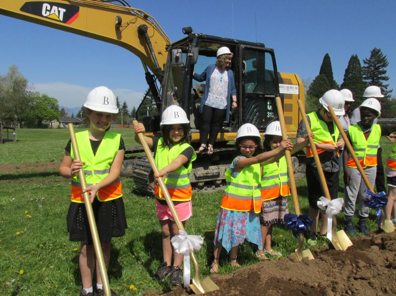 OUTLOOK PHOTO: TERESA CARSON - North Gresham Elementary School Principal Tracy Klinger oversees a group of North Stars getting ready for the ceremonial first shovel of dirt on Wedneday.