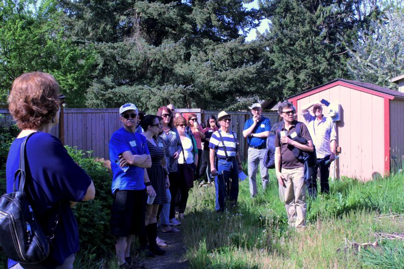 STAFF PHOTO: MARK MILLER - A tour group views a parcel of land across from the Juniper Gardens development in Forest Grove that Bienestar Oregon is considering for a new housing complex.