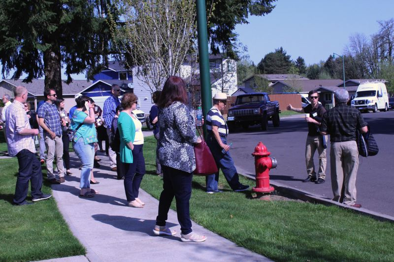 STAFF PHOTO: MARK MILLER - Bienestar Oregon executive director Nathan Teske (second from right) leads a tour group at the Juniper Gardens apartment complex in Forest Grove on Thursday, April 26.