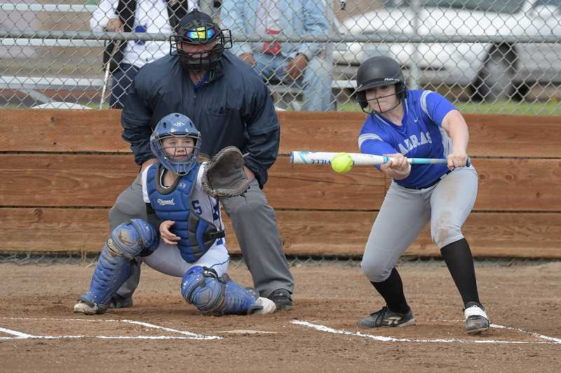 LON AUSTIN/CENTRAL OREGONIAN - Lizzie Steuart lays down a perfect bunt in the first inning of the White Buffalo's game with the Crook County Cowgirls. The White Buffalos scored three runs in the first inning, but the Cowgirls came back to take a 14-4 five-inning victory.