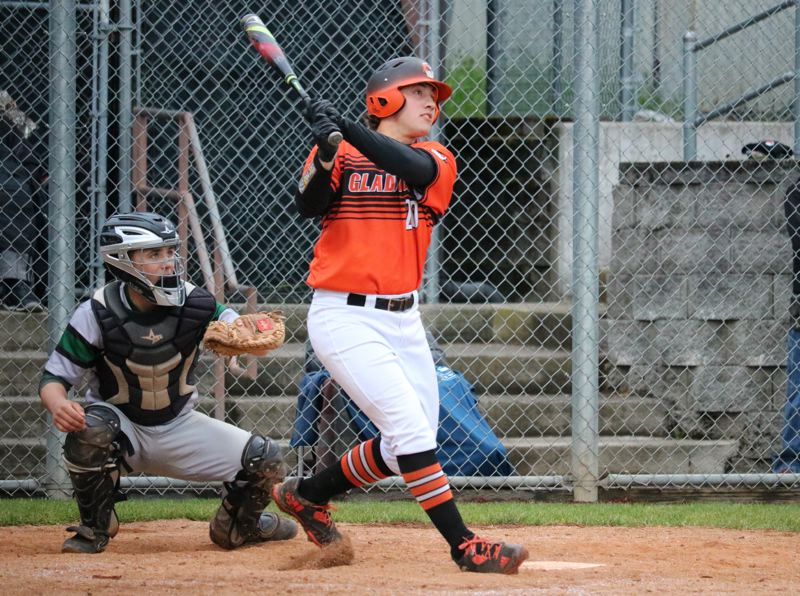 PAMPLIN MEDIA PHOTO: JIM BESEDA - Gladstone's Derek Lee went 3 for 4 with three doubles and an RBI, leading the league-leading Gladiators to an 8-1 Tri-Valley Conference home win Friday over Estacada.
