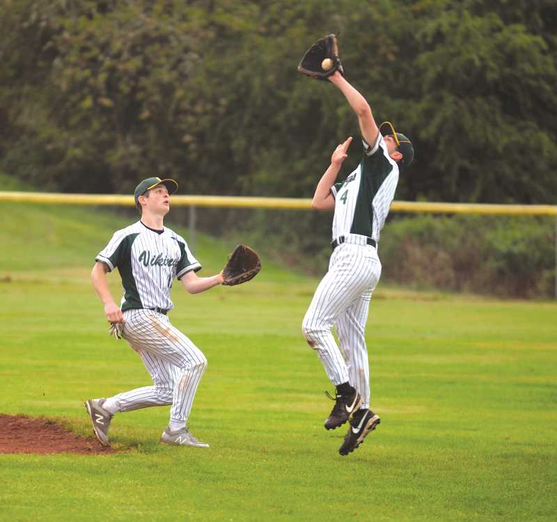 PIONEER PHOTO: TANNER RUSS - Colton junior Jack Boots fields a popfly against the Scio Loggers.