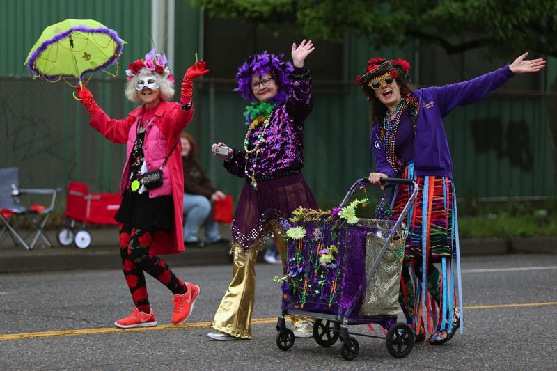 JESSIE DARLAND - The Mysti Krewe of Nimbus celebrate Mardi Gras at the 82nd Avenue Parade Saturday, handing out beads to kids.