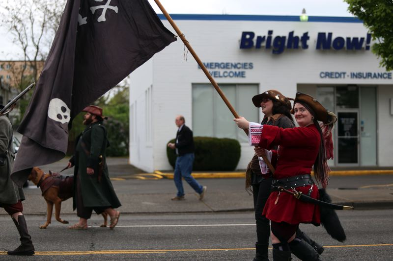 JESSIE DARLAND - Pirates wave their flag in the parade Saturday.