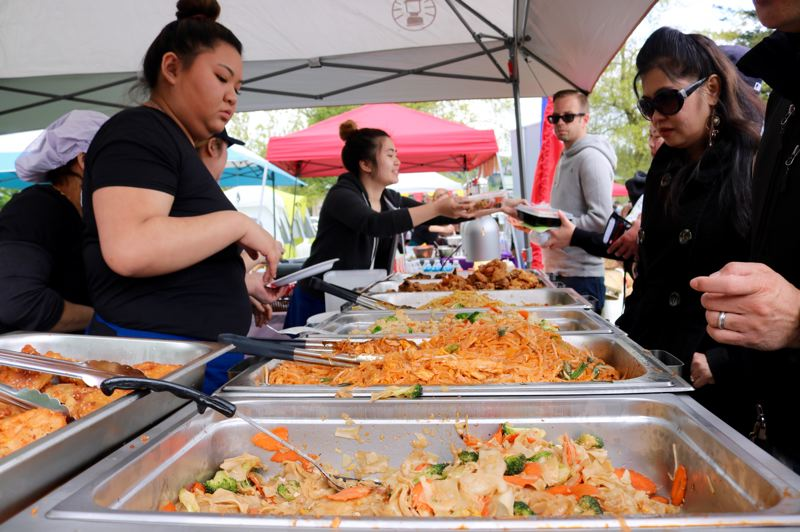 TRIBUNE PHOTO: ZANE SPARLING - About 12 vendors offered up authentic cusine during New Year in the Park on Saturday, April 28 at Glenhaven Park in Portland. In 2014, the event had only five food vendors, organizers say.